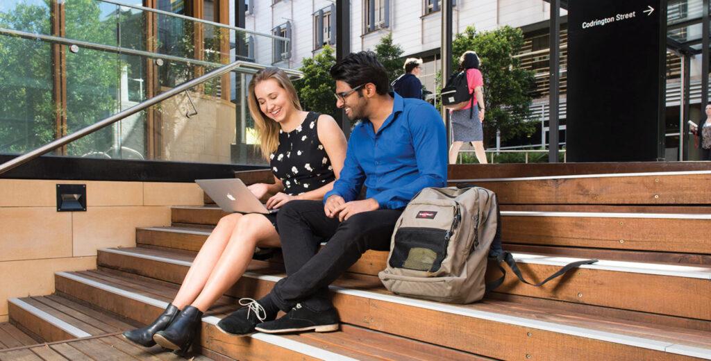Students sitting on stairway talking